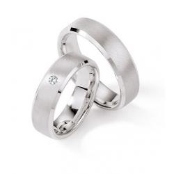 Stříbrné snubní prsteny v dámském prstenu s briliantem
