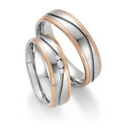 Pár snubních prstenů v kombinaci ocel se zlatem