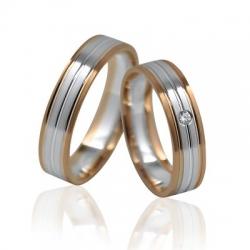 Pár luxusních zlatých snubních prstenů