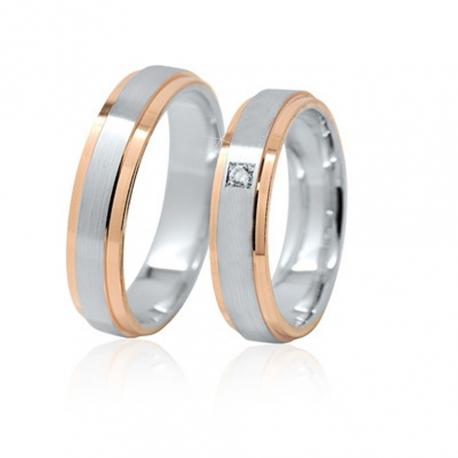 Pár zlatých snubních prstenů Ráj 1117BKO