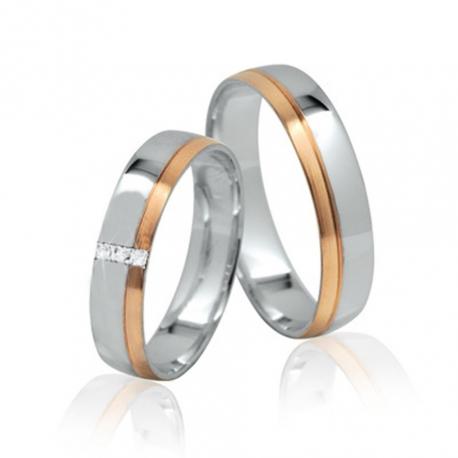 Pár zlatých snubních prstenů Ráj 1142FK