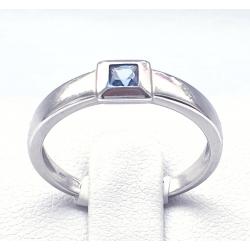 Prsten z bílého zlata s modrým kamenem