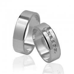 Pár zlatých snubních prstenů vel.54+60