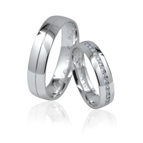 Pár zlatých snubních prstenů vel.53+61