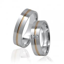 Pár zlatých snubních prstenů vel.55+62