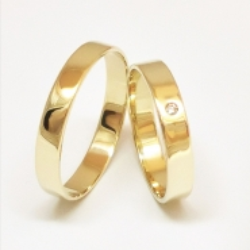 Pár zlatých snubních prstenů vel.54+62