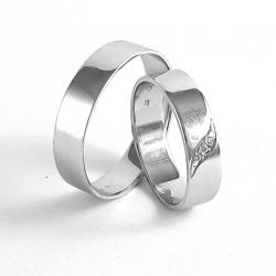 Pár zlatých snubních prstenů vel.53+63