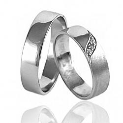 Pár zlatých snubních prstenů vel.52+60