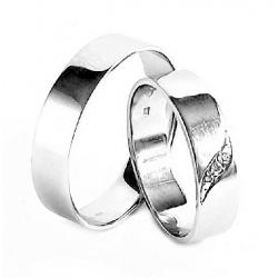 Pár zlatých snubních prstenů vel.53+64