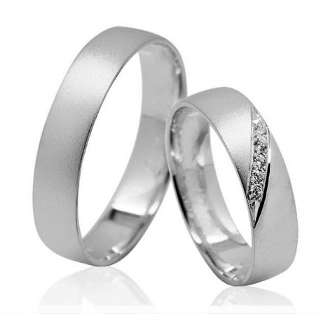Pár zlatých snubních prstenů vel. 52+62