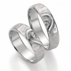 Luxusní snubní prsteny Signs of Love  z platiny s brilianty